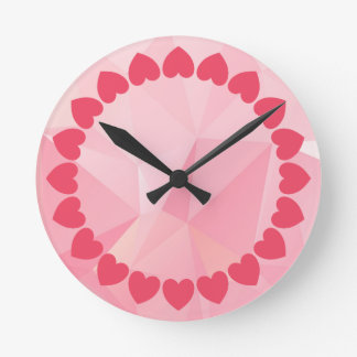 Pink wall clock with heart design