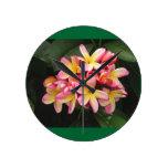 Pink, Yellow and Red Plumeria Flowers Round Clocks