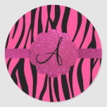 Pink zebra stripes monogram round stickers