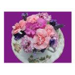 Pinks carnations in teacup postcard