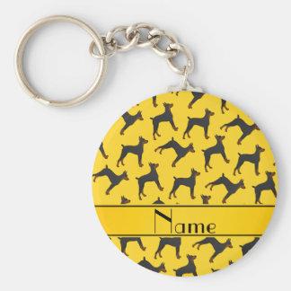 Pinschers amarillos conocidos personalizados del llavero redondo tipo pin