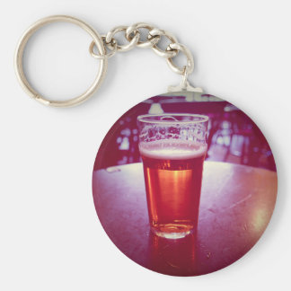 Pint of British ale beer in a pub Keychains