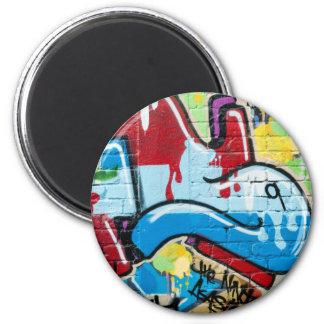 Pintada abstracta en la pared de ladrillo texturiz iman de frigorífico