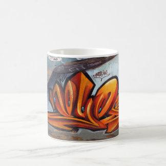 Pintadas urbanas del arte taza de café