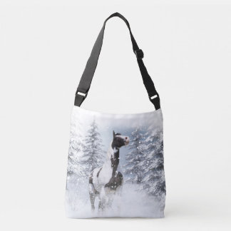 Pinto horse in snow crossbody bag