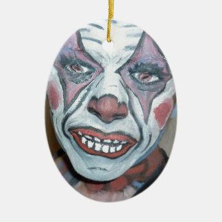 Pintura asustadiza de la cara del payaso de los pa ornamentos para reyes magos