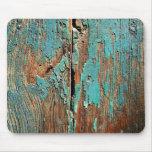 Pintura azul vieja en la madera tapetes de ratón