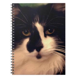 Pintura blanco y negro del gato libros de apuntes