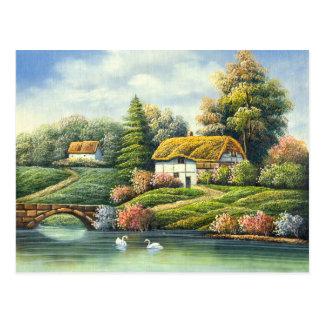 Pintura de cisnes en un lago cerca de un hogar postal