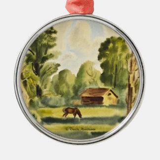 Pintura de la acuarela de la casa del leñador adorno navideño redondo de metal