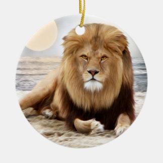 Pintura de la foto del océano del león adorno navideño redondo de cerámica
