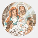 Pintura de la natividad con los pequeños muchachos pegatina redonda