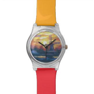 Pintura del molino de viento de la puesta del sol  relojes de mano