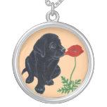 Pintura negra del perrito y de la amapola de Labra Pendiente