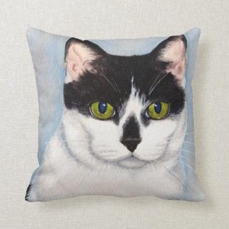 Pintura negra y blanca de ojos verdes del gato cojin
