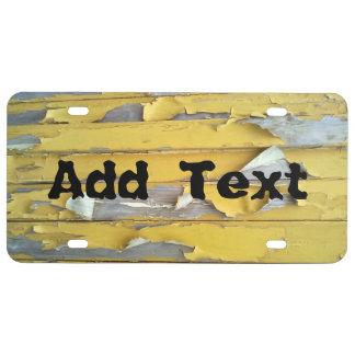 pintura que forma escamas amarilla de la pared placa de matrícula