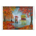 Pintura roja de la tranvía del paraguas del otoño  tarjeton
