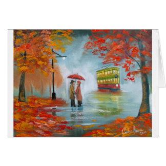 Pintura roja de la tranvía del paraguas del otoño  tarjeta de felicitación