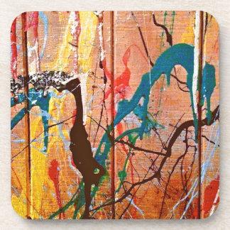 Pintura salpicada artística en la madera posavasos