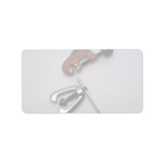 Pipe cutter and reamer address label