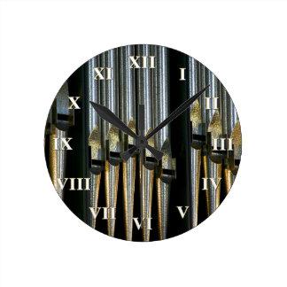 Pipe organ clock with roman numerals