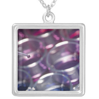 Pipette and petri dishes with fluids silver plated necklace