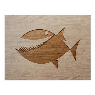 Piranha silhouette engraved on wood design postcard