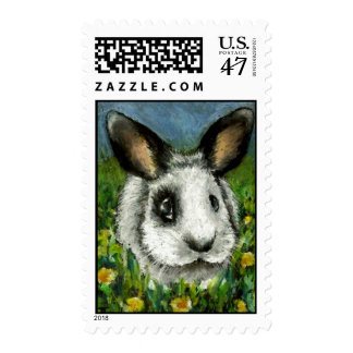Pirate bunny in a dandelion sea postage stamp