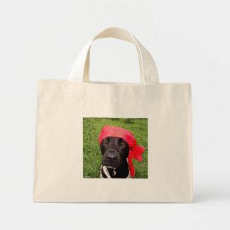 Pirate dog, black lab, red hankerchief green grass mini tote bag