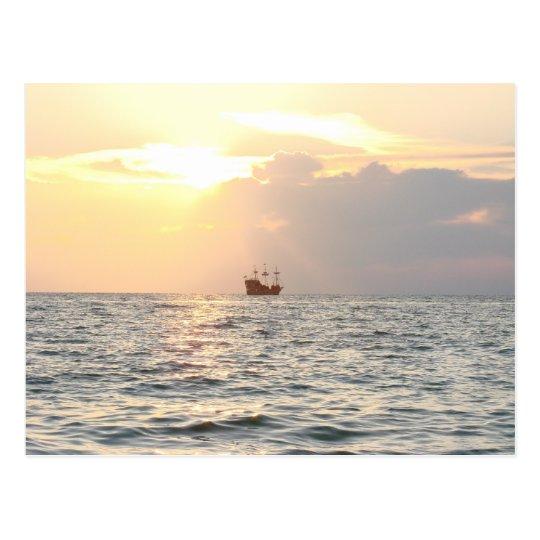 Pirate ship in Sunset Postcard