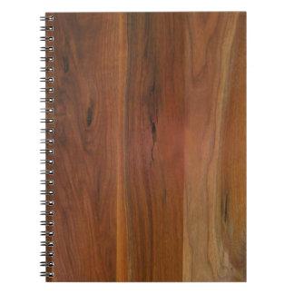 Piso de madera oscuro del grano spiral notebooks