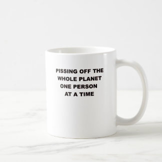 PISSING OFF THE WHOLE PLANET.png Coffee Mug