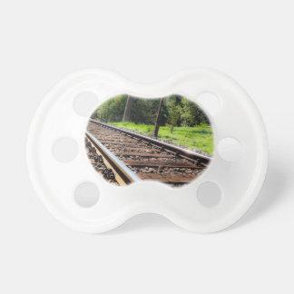 pista de ferrocarril chupetes para bebés