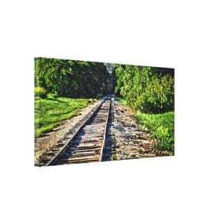 Pista de ferrocarril que lleva en las maderas impresión en lienzo