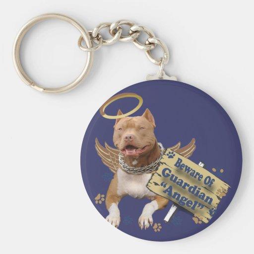 Pitbull se guarda de los regalos del ángel de guar llavero