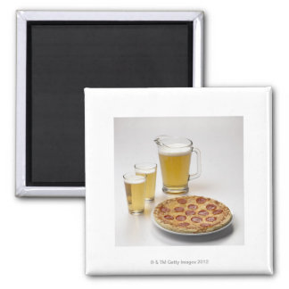 Pitcher and two pints of beer beside pepperoni 2 inch square magnet