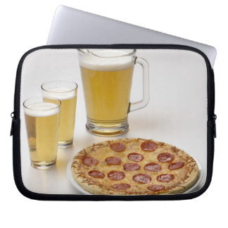 Pitcher and two pints of beer beside pepperoni computer sleeve