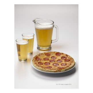 Pitcher and two pints of beer beside pepperoni postcard