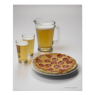 Pitcher and two pints of beer beside pepperoni poster
