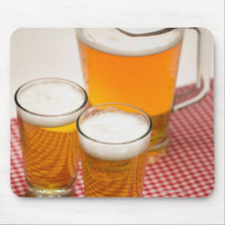 Pitcher of beer and two glasses filled with beer mousepad