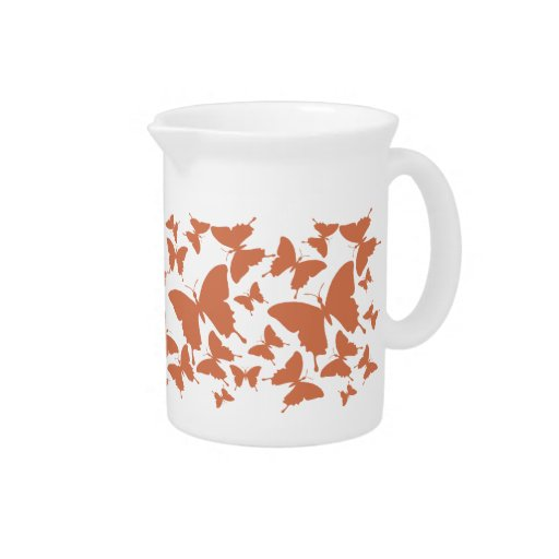Pitcher with butterfly pattern in orange