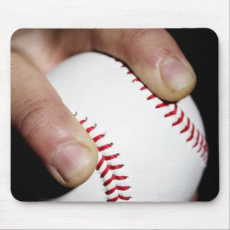 Pitchers hand gripping a baseball mouse pad