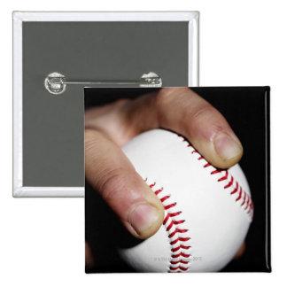 Pitchers hand gripping a baseball pinback button