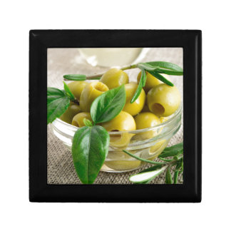 Pitted olives with green leaves and rosemary jewelry box