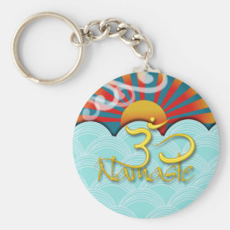 PixDezines namaste+wind+water+sunburst+om Keychain