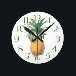 "PixDezines Vintage Pineapple/DIY Color/Font Round Clock<br><div class=""desc"">PixDezines Vintage Pineapple illustrated by Pierre Joseph Redoute.  DIY font and color. com™ and PixDezines™ on zazzle.com.  All rights reserved.</div>"