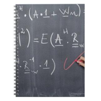 Pizarra con la aritmética en ella, primer note book