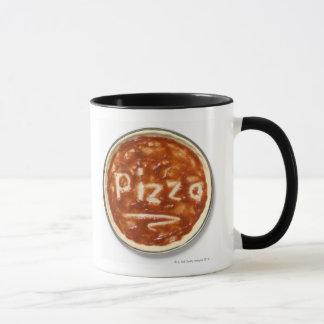 Pizza base with tomato sauce and the word mug