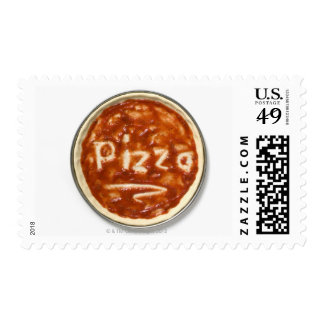 Pizza base with tomato sauce and the word postage stamp