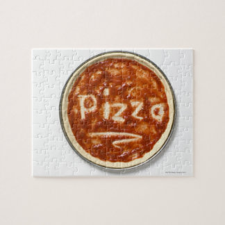 Pizza base with tomato sauce and the word puzzle